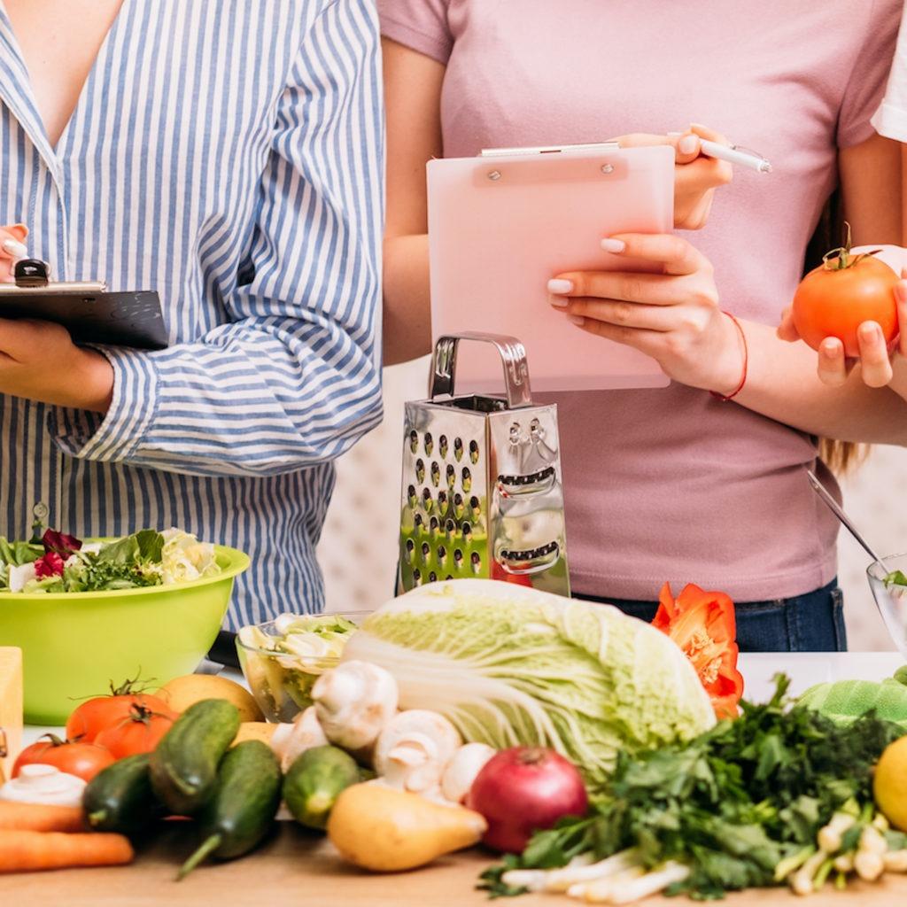 Women in front of food